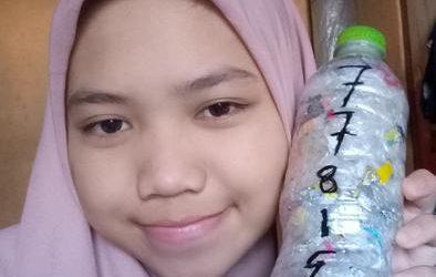 """""""Bumi aman dan damai"""" by Alicia Puspita Maharani ecobricking in Indonesia using  CoV-19 Enhanced Ecobricking"""